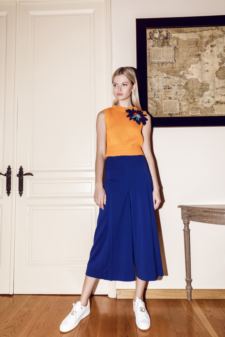 Orange cotton knitted top paired with navy silk skirt.